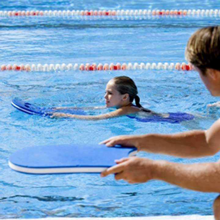 child receiving school swimming lessons