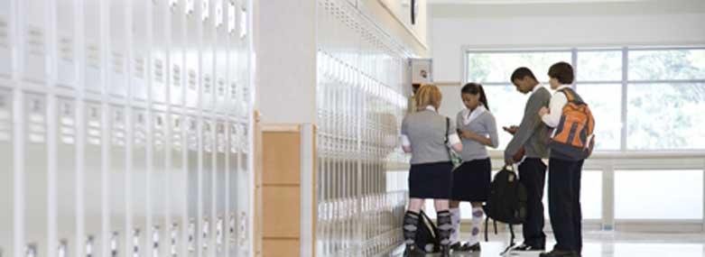 school children stood around school lockers