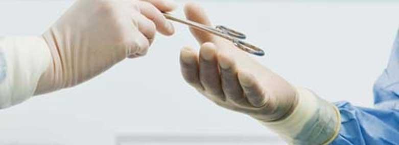 surgeons handing a pair of scissors between each other