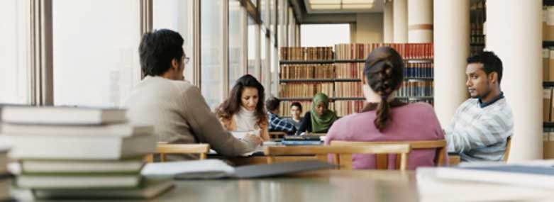 Students researching in a library