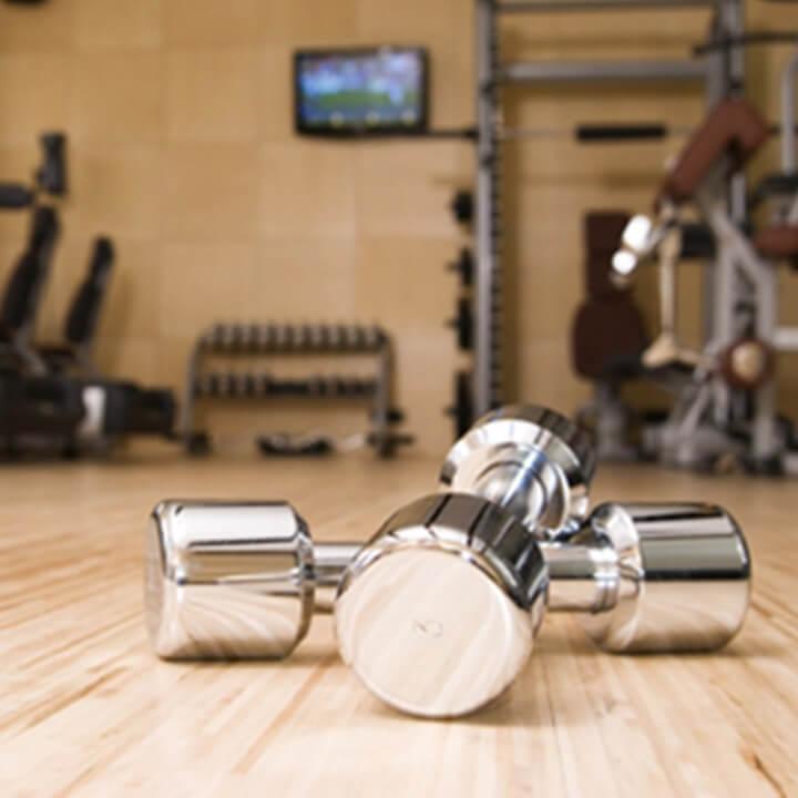 dumbells on a wooden gym floor