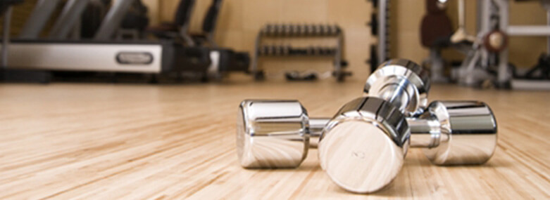 dumbells on a wooden gym floor