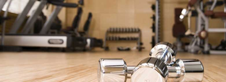 weights in a gym on a wooden floor