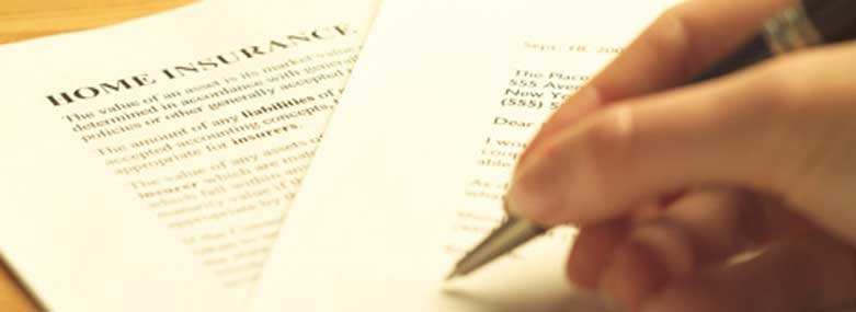 person signing an home insurance document