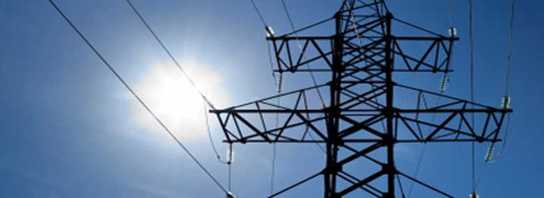 Image of the top 'of a pylon with blue sky and sun behind