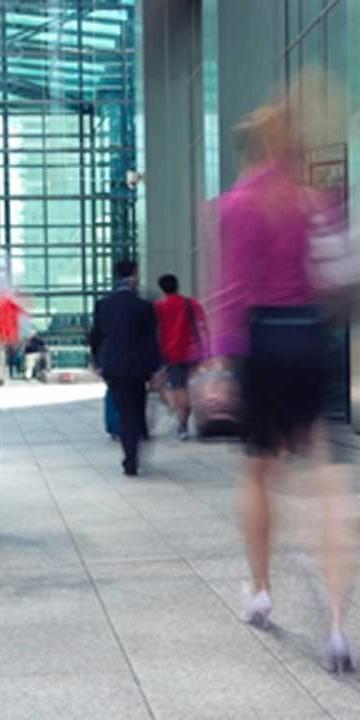 people walking in a pedestrian precinct