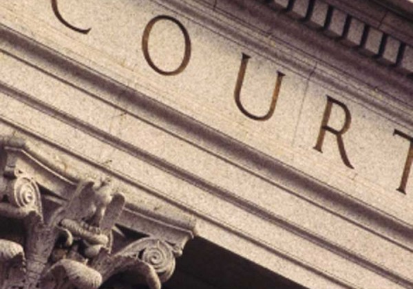 The word 'court' cut into a plinth on top of a column