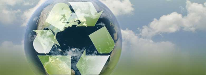 Abstract recycling logo on a globe with blue/cloudy sky behind globe
