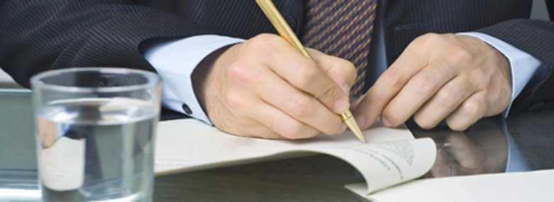 person writing on a document