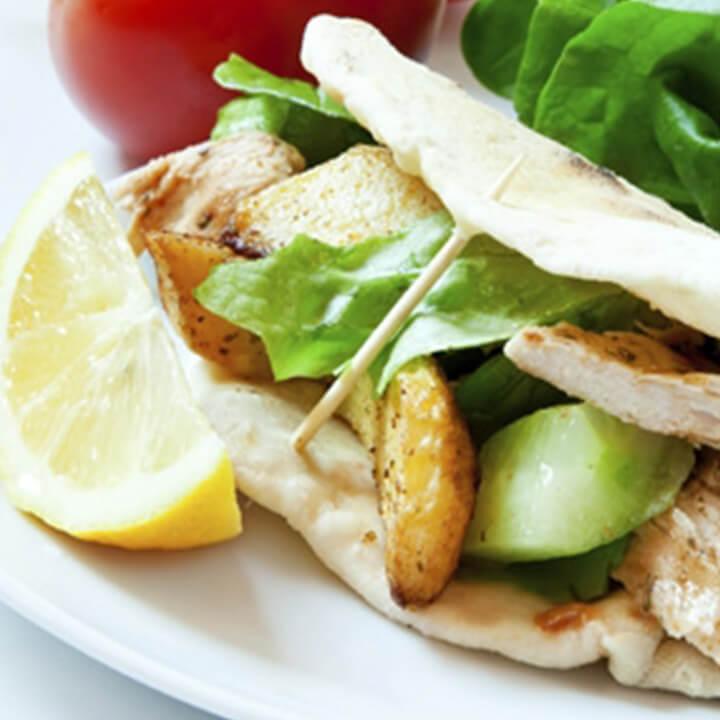 chicken salad sandwich with a slice of lemon