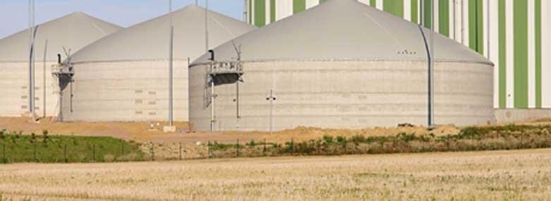 grain / crop silos behind a field
