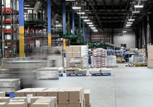 commercial warehouse wth packages on shelves and floor