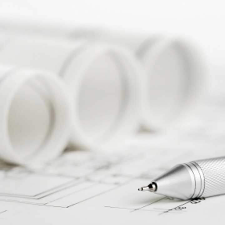 planning documents with a silver pen