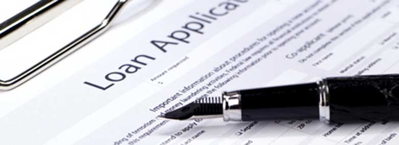 Loan application form with a black fountain pen