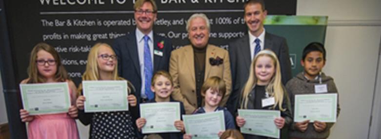 Children holding prize certificates