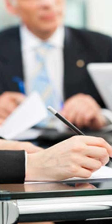 People writing on paperwork