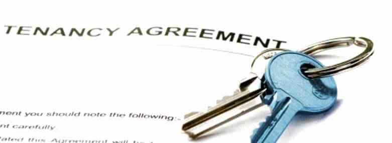 two keys n top of a tenancy agreement