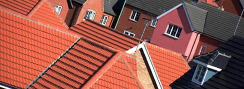 Red tiled rooftops of new build houses