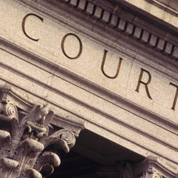 The word 'Court' cut into a plinth with columns