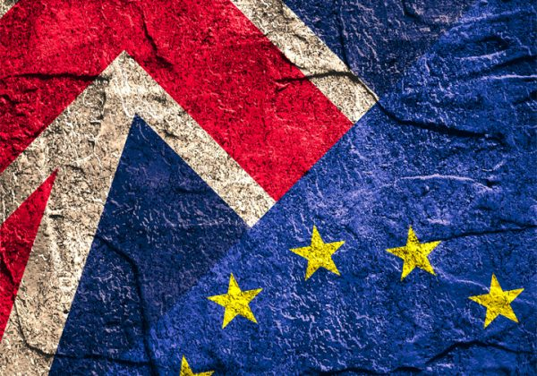 Image relative to political relationships between Europe Union and United Kingdom. National flags on concrete textured backdrop. Brexit and Great Repeal Bill theme