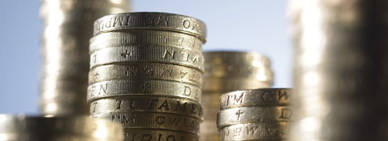 Stacked British pound coins