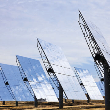 Image of an array of solar panels, which produce energy.