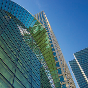 image of skyscrapers in a business environment with a vivid blue sky