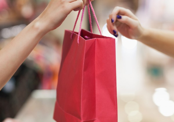 Handing over a shopping bag