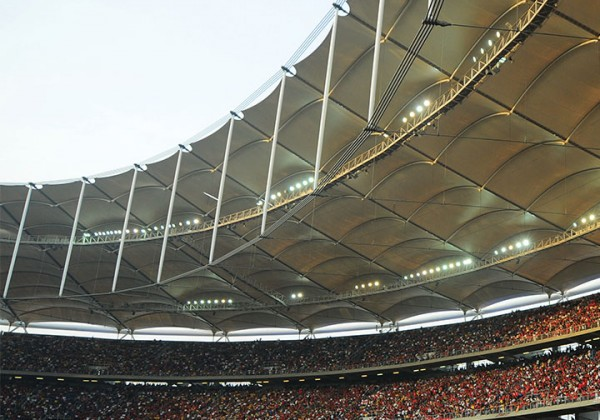 3 tiers of a sports stadium with a roof