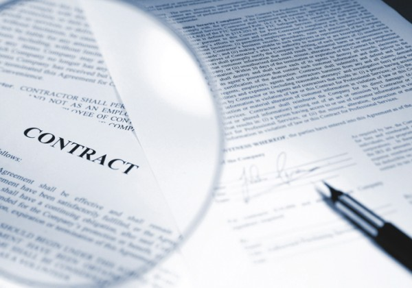 Contract with magnifying glass