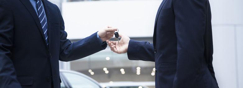 Car key exchange between businessmen