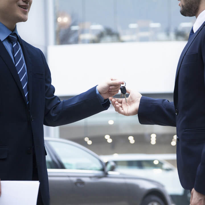 Car key exchnage between businessmen