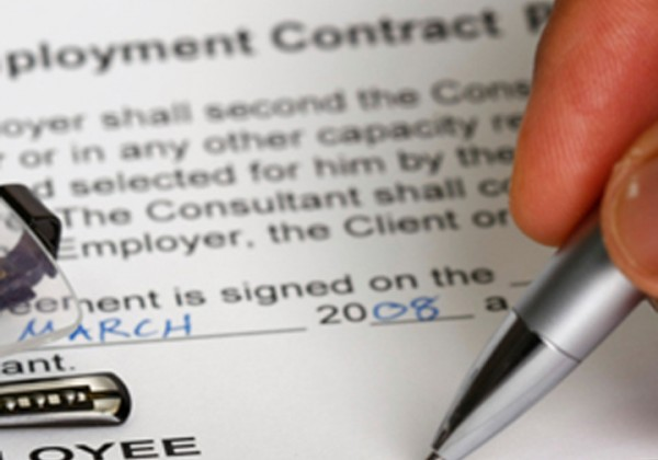 Person signing an Employment contract
