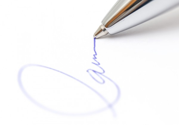 A silver pen completing signatures