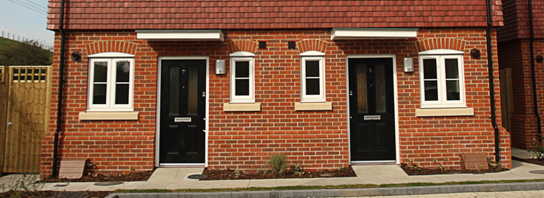 New build semi-detached houses with black doors