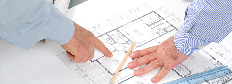Construction plan witrh people pointing at it
