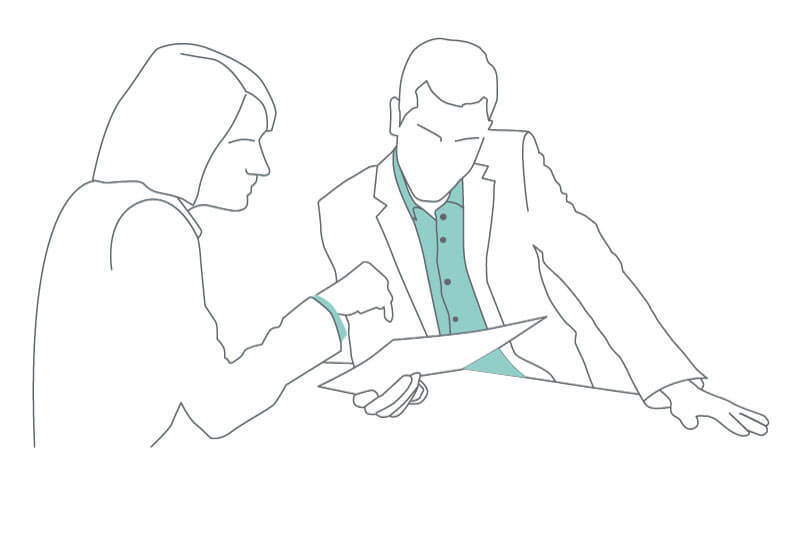 line drawing of a man and woman looking at a sheet of paper