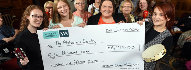 Staff from Walker Morris present a cheque to the Alzheimer's Society