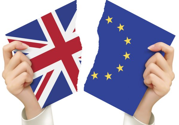 Two torn flags - EU and UK in hands. Brexit concept.