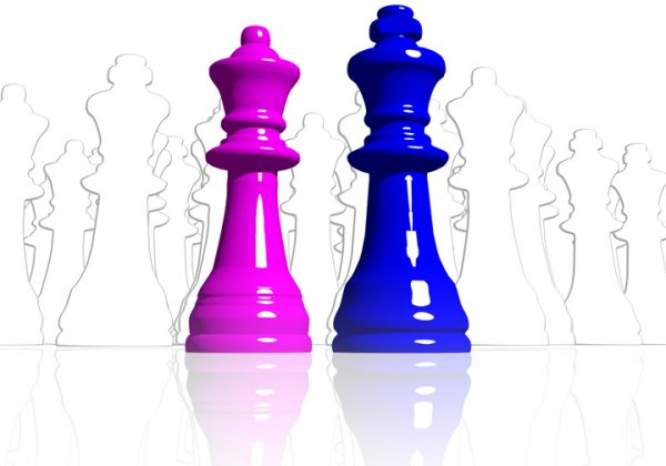 Line drawing of a queen and king chess peices and a solid pink queen and blue king chess peice