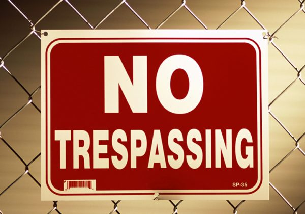 No trespassing sign on a chain-link fence