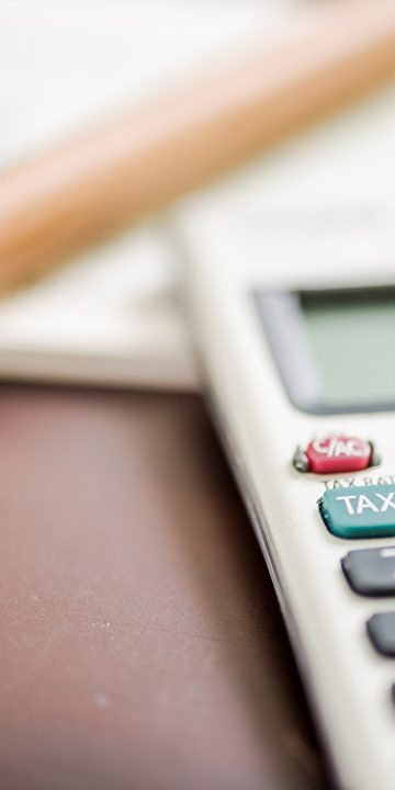Taxation and accounting concept with pen and calculator