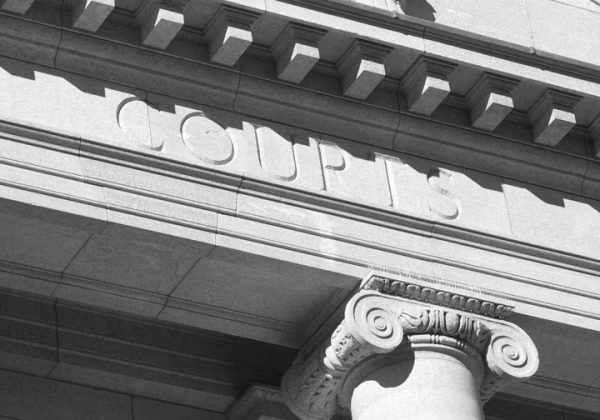 Court exterior with columns and plinths with the word courts engraved