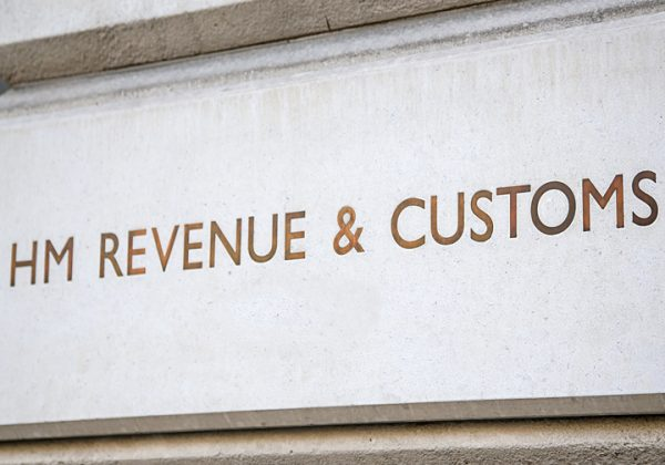 HM Revenue & Customs sign incised into the wall outside their headquarters in Whitehall, City of Westminster, London