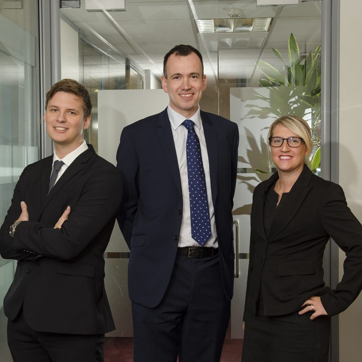 Newly appointed construction associates, Hayley Hayes, Associate (right) and Alex Jones, Associate (left) with Jules Harbage, Partner (Centre)