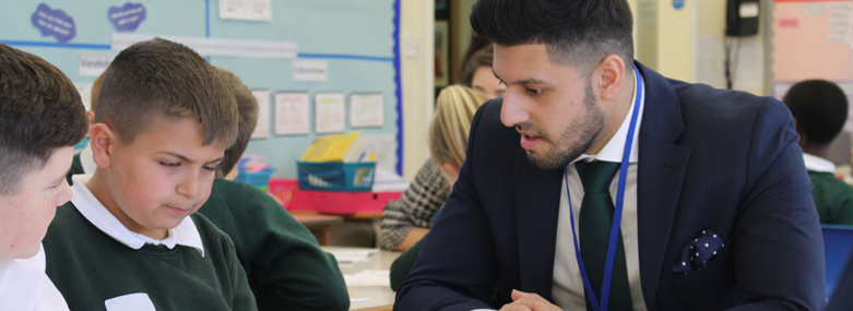 Inam Hassan talking to pupil during Leeds Legal Education Week