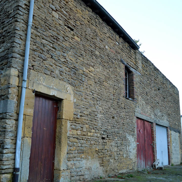Old stone barn with garage doors