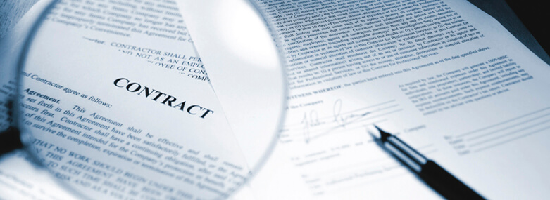 Contract with magnifying glass and pen