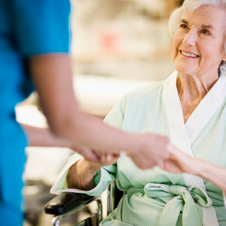Nurse Holding Hands with Elderly Patient