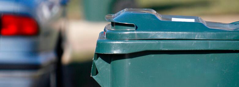 Rubbish bins on street - green
